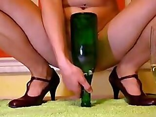 Huge green glass bottle was inserted in lusty nymphos pussy deep